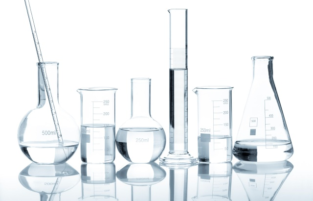 Group of laboratory flasks with a clear liquid